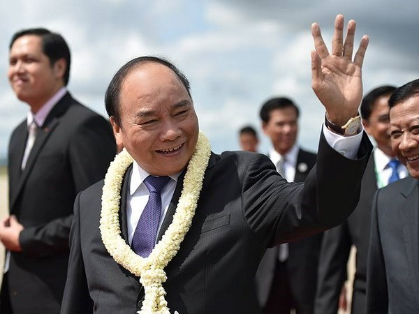 Prime Minister arrives in Cambodia for CLV9 hinh anh 1