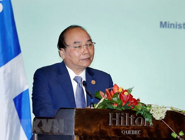 PM introduces investment opportunities to Canadian firms hinh anh 1