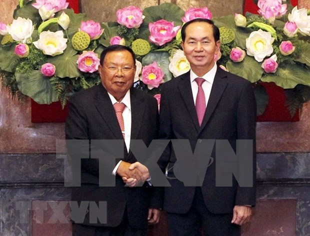 Top Lao leader pays five-day visit to Vietnam hinh anh 2