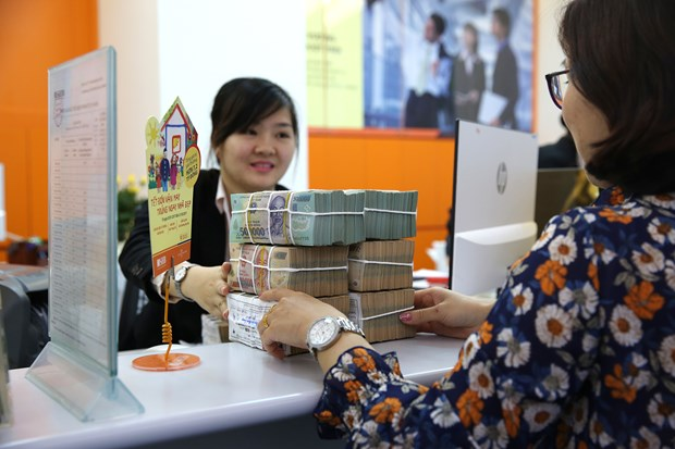Six-month profit hikes: Banks cautious with bad debts hinh anh 4