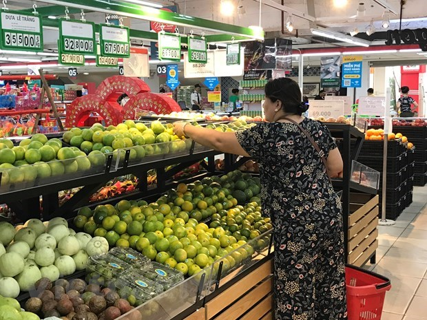 Agricultural products face tough way to enter supermarkets hinh anh 1