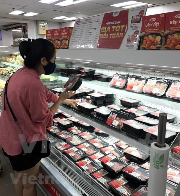 Hanoi's enterprises increase goods stockpile amid COVID-19 outbreaks hinh anh 2