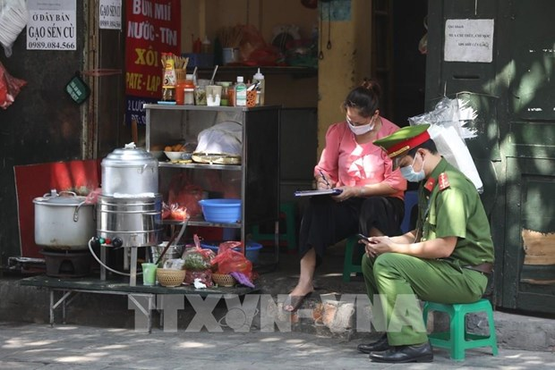 Hanoi raises COVID-19 alert following new infections hinh anh 1