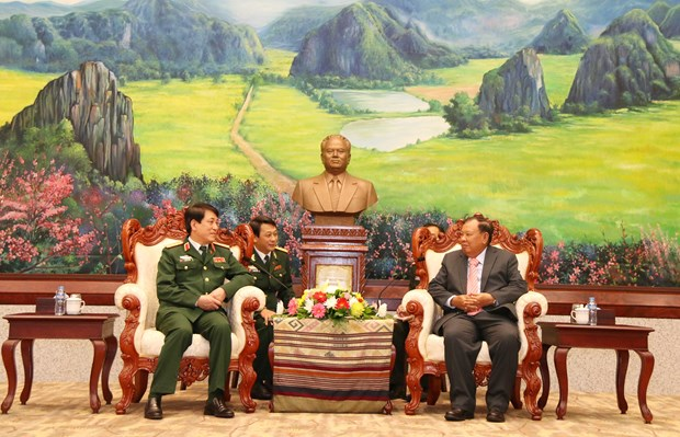 Lao Party General Secretary speaks of military cooperation with VN hinh anh 1