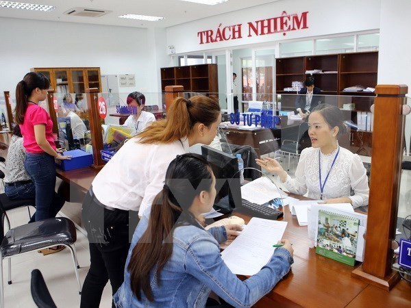 Workshop looks into wage policy reform in public sector hinh anh 1