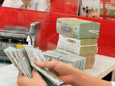 Reference exchange rate goes up by 13 VND hinh anh 1