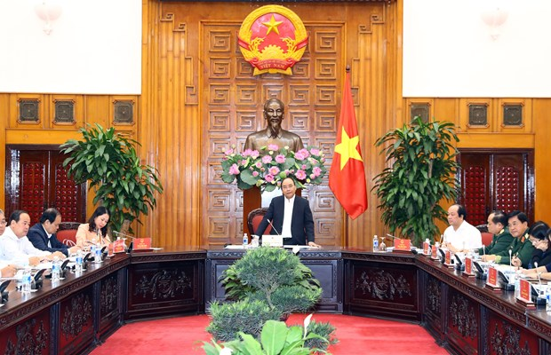 PM works with An Giang on key socio-economic project implementation hinh anh 1