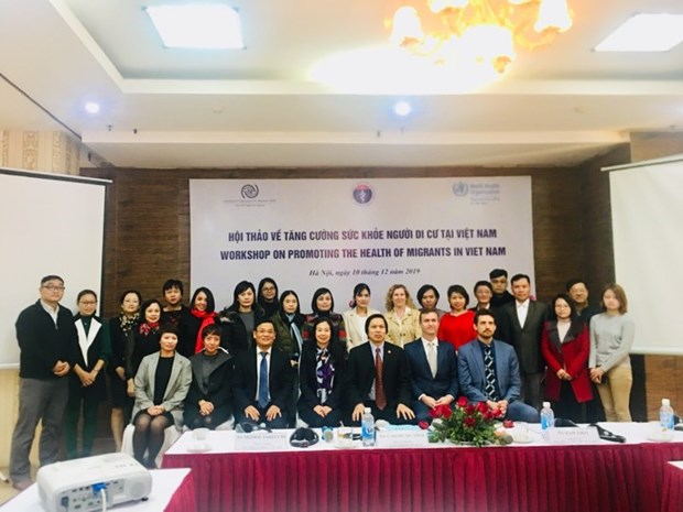 Workshop discusses migrants' health in Vietnam hinh anh 1