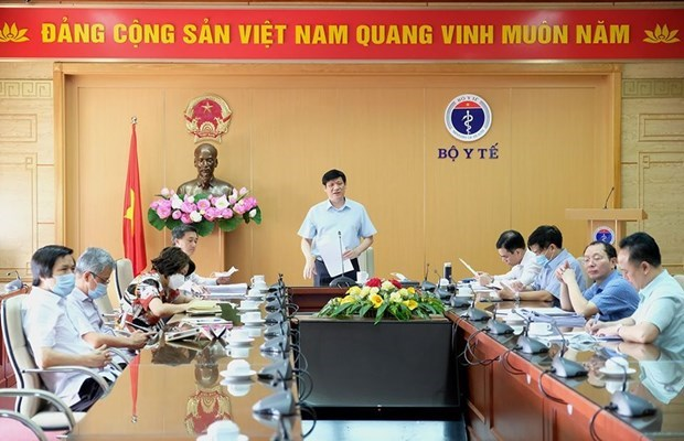 Risks of new COVID-19 outbreaks still exist: Health Ministry hinh anh 2