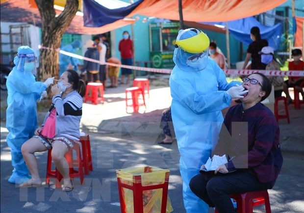 Vietnam records over 1,000 COVID-19 cases: No room for carelessness hinh anh 2