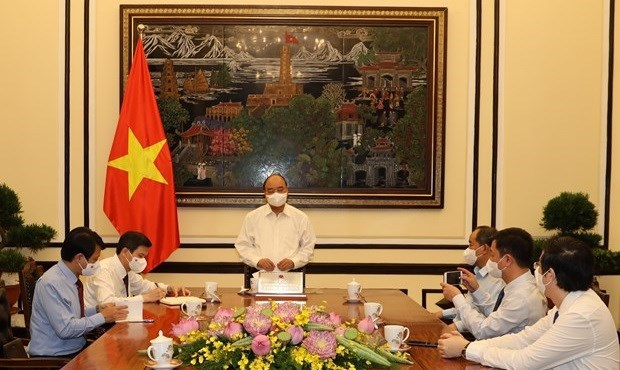President Nguyen Xuan Phuc works with Communist Review hinh anh 1