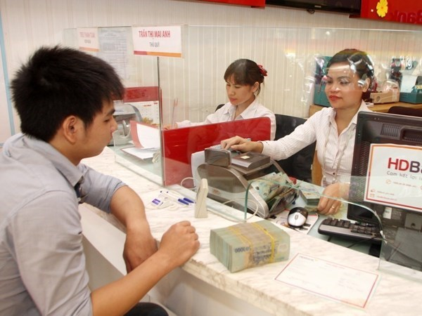 Banks try to work as fulcrum for enterprises amidst pandemic hinh anh 1