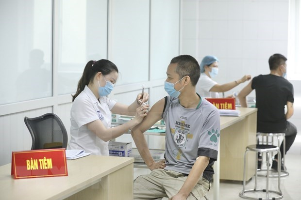 COVID caseload surpasses 10,000, Vietnam strives to curb the pandemic hinh anh 5