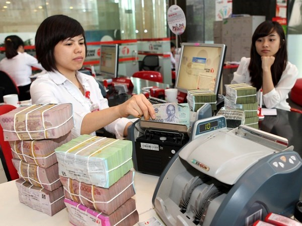 Measures applied to prevent COVID-19 from harming banks, businesses hinh anh 1