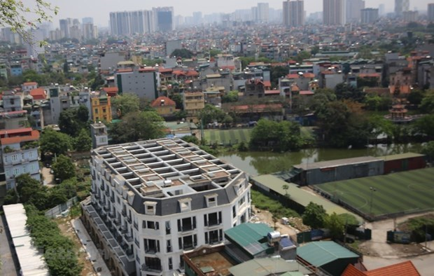 Removal of overlapping in policies helps boost investment in property market: experts hinh anh 1
