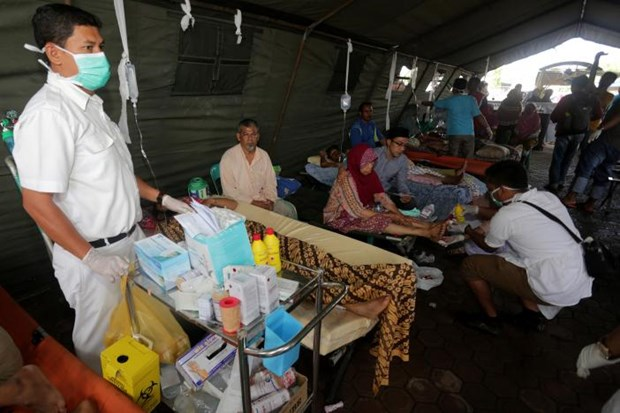 Death toll in Indonesia quake approximates 100 hinh anh 1