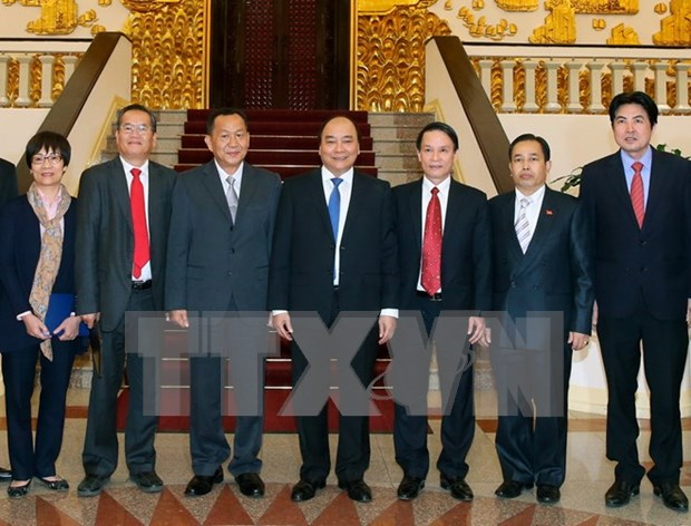 PM asks Vietnamese, Lao news agencies to foster links hinh anh 1