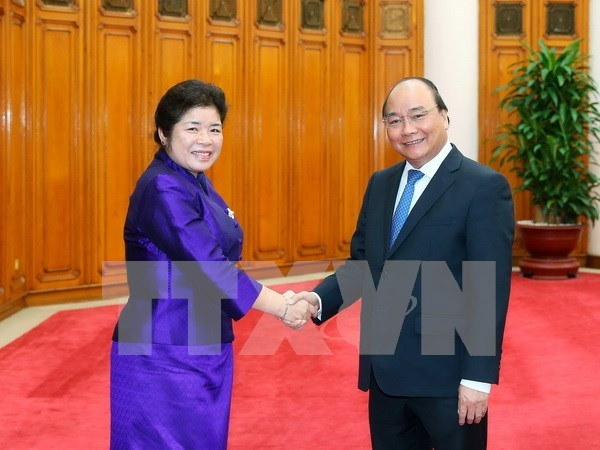 Government offices work to bolster Vietnam-Laos relations hinh anh 1