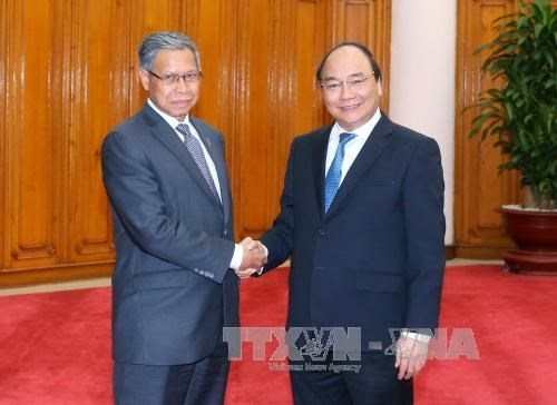 PM urges measures to bolster trade with Malaysia hinh anh 1