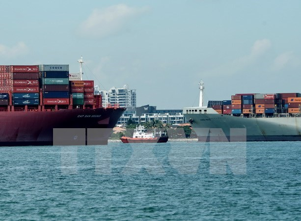Lower economic growth forecast for Singapore hinh anh 1