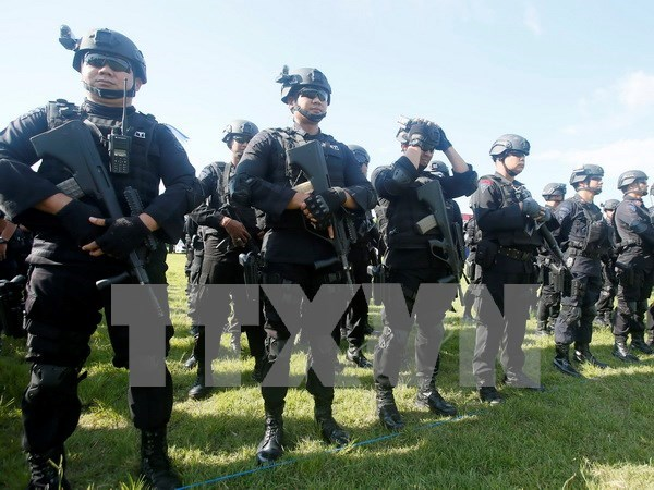 Indonesia: More police deployed to protect Christmas, New Year holidays hinh anh 1