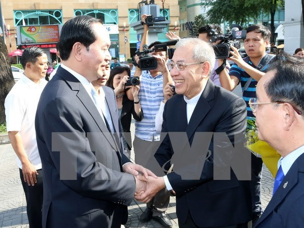 President congratulates HCM City parishioners on Christmas hinh anh 1