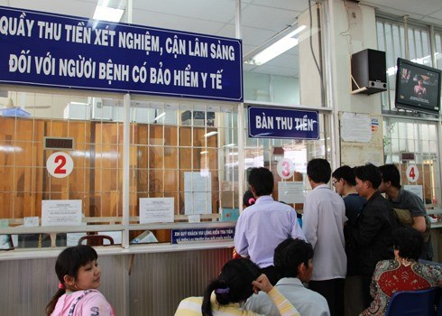 Red tape slows health insurance sign-up hinh anh 1