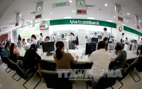 Banks to buy back bad debts from VAMC hinh anh 1