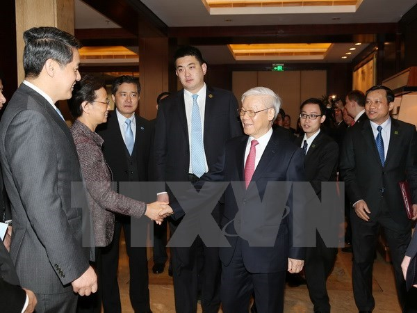 Party chief highlights firms' role in Vietnam-China relations hinh anh 1