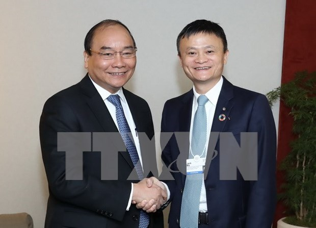 Prime Minister meets with int'l finance and business executives hinh anh 2
