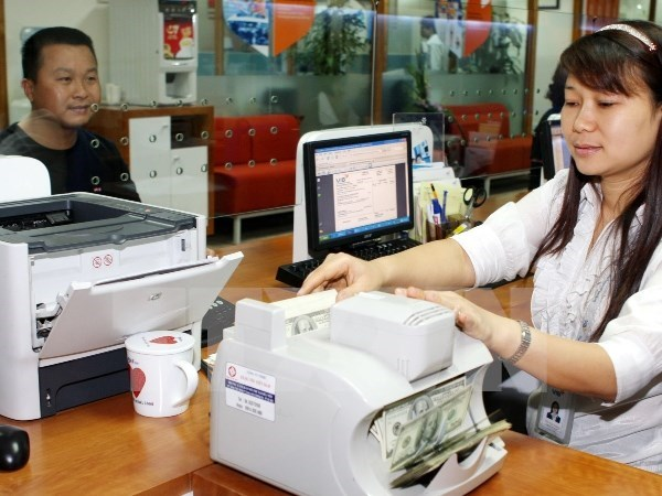 Reference exchange rate goes down 1 VND hinh anh 1