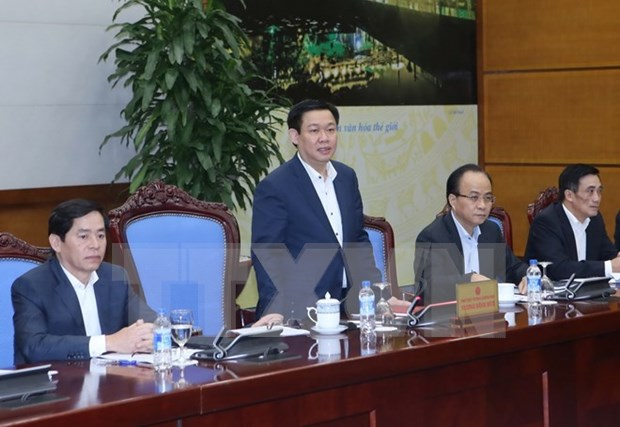 Meeting reviews government's resolution on business development hinh anh 1