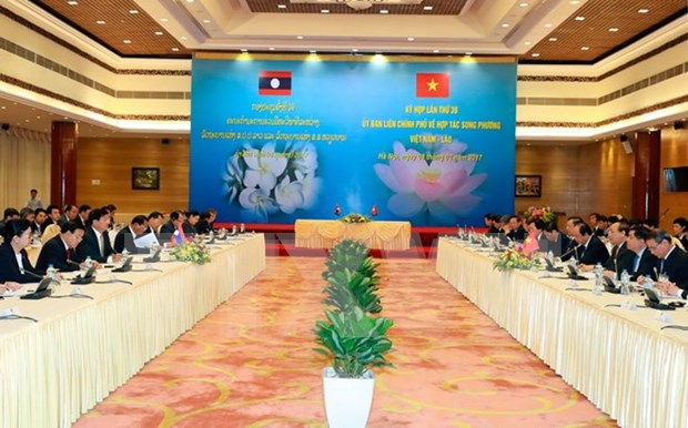 Lao media spotlights Vietnam-Laos committee meeting' success hinh anh 1