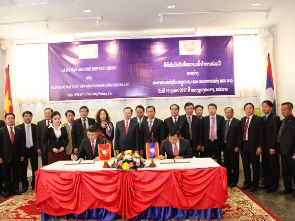 Vietnam, Laos boost banking cooperation hinh anh 1