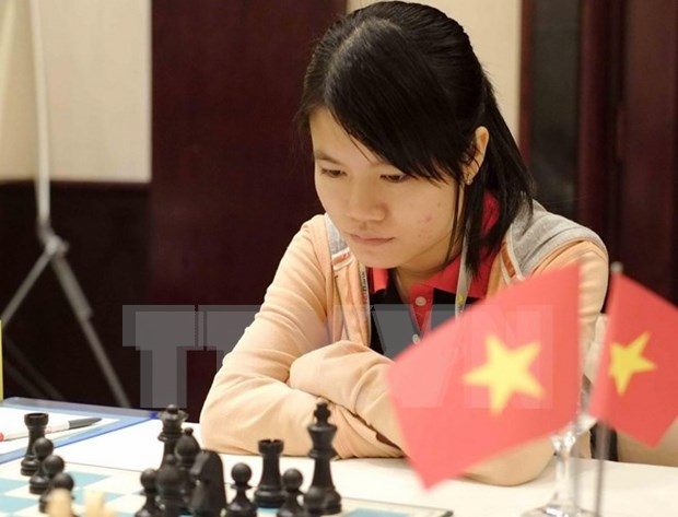 Vietnamese player stops in third round of world chess champs hinh anh 1