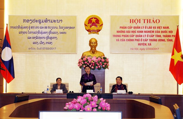 Vietnam, Laos share experience in management decentralisation hinh anh 1