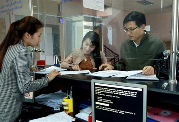 Firms happy with tax reforms, want further simplification hinh anh 1