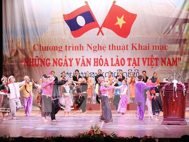 Greetings to Lao party on 62nd anniversary hinh anh 1