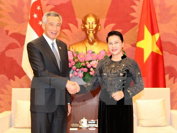 Vietnam legislature delighted with ties with Singapore hinh anh 1