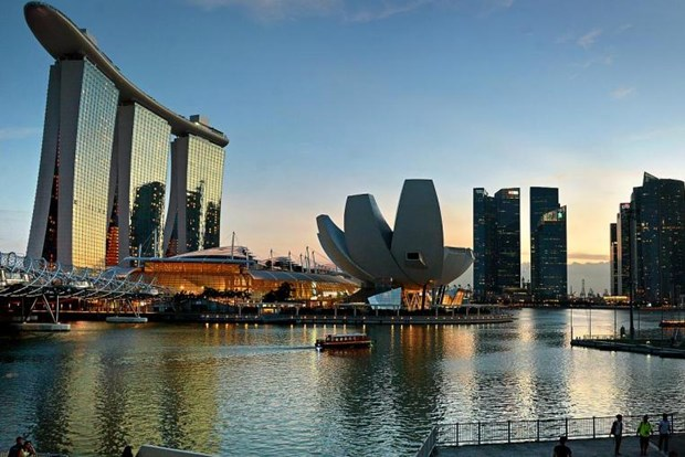 Foreigners flock to Singapore despite high living cost hinh anh 1