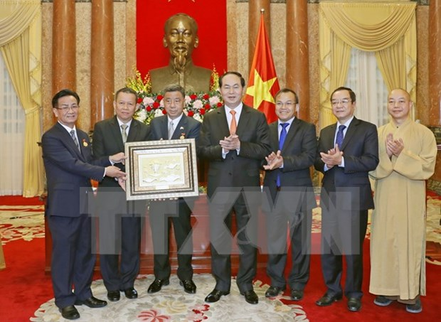 President receives Overseas Vietnamese, Buddhists from Thailand hinh anh 1