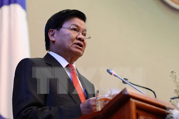 Lao PM calls for measures to improve investment climate hinh anh 1