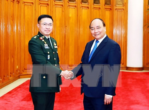 PM vows to facilitate Vietnam-Thailand military cooperation hinh anh 1