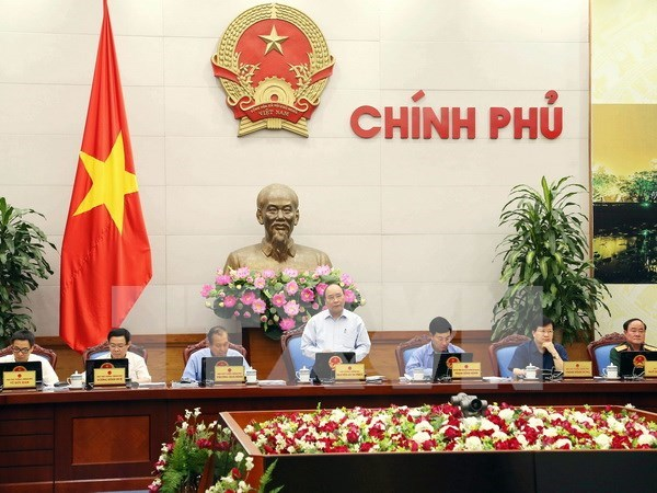 Government holds symposium on law making hinh anh 1