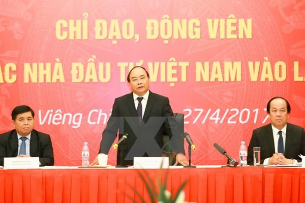 PM praises efforts of Vietnamese investors in Laos hinh anh 1