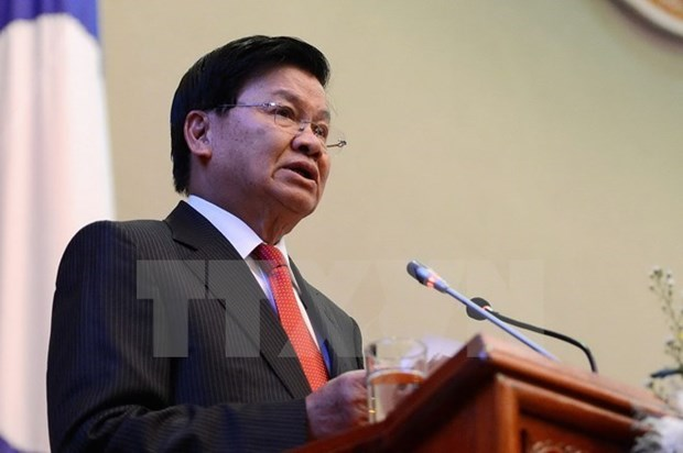 Lao Prime Minister visits Singapore hinh anh 1