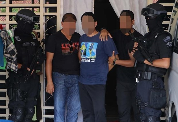 Malaysia arrests six with links to IS hinh anh 1