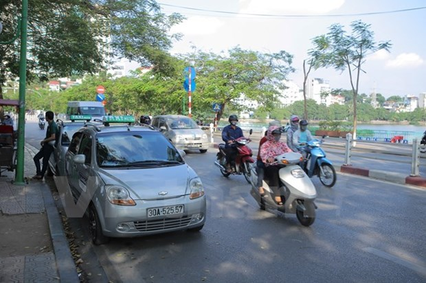 Carpool service GrabShare makes debut in HCM City hinh anh 1