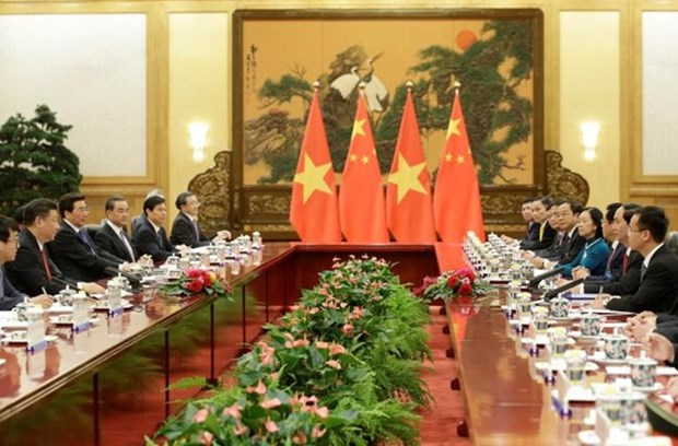 President reiterates friendly ties with China during talks hinh anh 1
