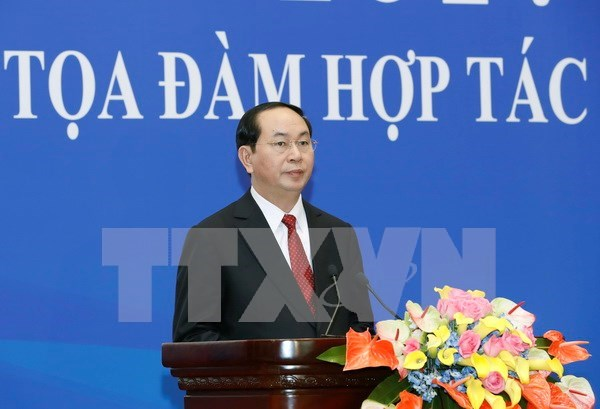 President attends Vietnam-China economic, trade cooperation seminar hinh anh 1
